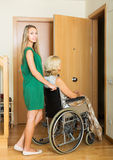 Social worker and disabled woman Stock Image