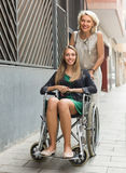 Social worker and disabled woman at stroll Stock Image