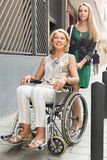 Social worker and disabled woman at stroll Royalty Free Stock Photography