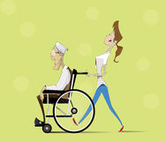 Social worker and elder man in wheelchair. Stock Photo