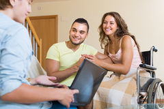Social worker and invalid with husband Stock Image
