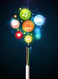 Sociala massmediasymboler som kommer ut ur elektrisk kabel royaltyfria bilder