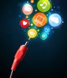 Sociala massmediasymboler som kommer ut ur elektrisk kabel fotografering för bildbyråer