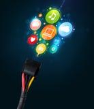 Sociala massmediasymboler som kommer ut ur elektrisk kabel Royaltyfri Foto