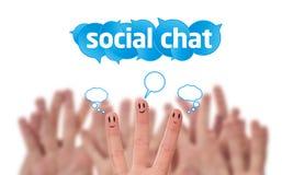 sociala smileys för sig för pratstundfingergrupp Arkivfoto