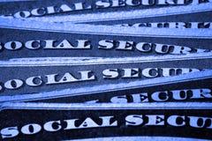 Sociale zekerheidkaarten die Financiën en Pensionering vertegenwoordigen Royalty-vrije Stock Foto's