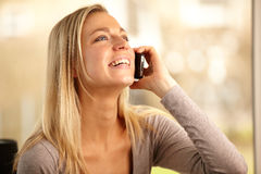Socialising Over The Phone. Beautiful woman talking on the phone Stock Photo