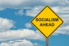 Socialism Ahead Warning Sign. Socialism Ahead Caution Sign With Blue Sky Background stock photos