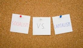 Socialisme contre le capitalisme photographie stock libre de droits