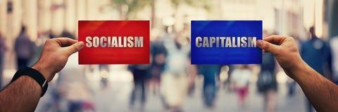 Socialismo contra o capitalismo fotografia de stock