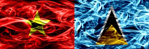 Socialist Republic of Viet Nam vs Saint Lucia smoke flags placed side by side. Thick colored silky smoke flags of Vietnam and Sain. T Lucia royalty free illustration