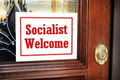 Socialist Welcome Sign. On home front door stock photo