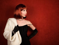 Socialite with brassy red hair Stock Images