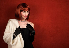 Socialite with brassy red hair Royalty Free Stock Images