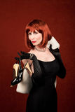 Socialite with brassy red hair Royalty Free Stock Photography