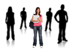 Socialize. An attractive young student standing within several silhouettes of other persons. All on white background Stock Photo