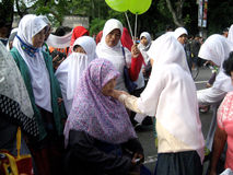 Socialize hijab. Muslim women to socialize hijab on the street in the city of Solo, Central Java, Indonesia Royalty Free Stock Images