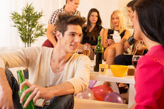 Socializing At House Party Stock Images