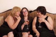 Socializing woman. Three well dressed and diverse woman socializing with wine Stock Photos