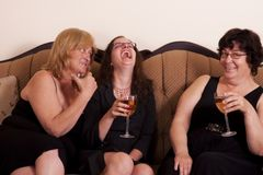 Socializing woman. Three well dressed and diverse woman socializing with wine Royalty Free Stock Image