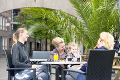 Socializing women. Three women of various ages and in different stages of life socializing and having fun on a terrace at a cafe bar. A concept of diversity Stock Photo