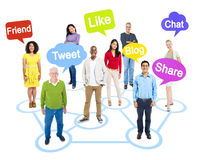 Socially Connected People with Speech Bubbles. Group of Multi-Ethnic Socially Connected People with Speech Bubbles Above Them royalty free stock images