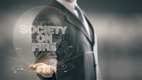 Society On Fire Businessman Holding in Hand New technologies stock video footage