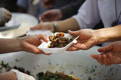 The society of helping to share food to the poor.  Stock Image