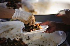 The society of helping to share food to the poor.  Royalty Free Stock Images