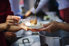 The society of helping to share food to the poor Stock Image
