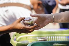 The society of helping to share food to the poor.  Royalty Free Stock Photos