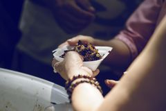 The society of helping to share food to the poor.  Royalty Free Stock Image