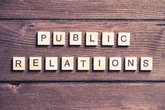 Society and public relations. Concept of social media collected of wooden elements with the letters Stock Photos