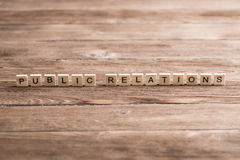 Society and public relations. Concept of social media collected of wooden elements with the letters Stock Images