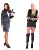 Socila diversity two women one with pistol Royalty Free Stock Photography