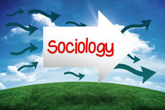 Sociology against green hill under blue sky. The word sociology and arrow against green hill under blue sky Royalty Free Stock Image