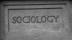 `Sociology` In Roman Style Stone Carving. Stone marble imitation carving, showing the word `Sociology Stock Image