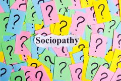 Sociopathy Syndrome text on colorful sticky notes Against the background of question marks Stock Photography