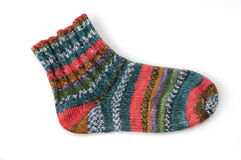 Sock. Colorfull, handmade sock in front of a white background royalty free stock image