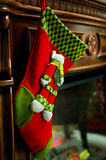 Sock. Christmas sock on a fireplace is ready for gifts stock photo