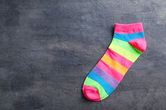 Sock. Colorful sock on a grey table stock photography