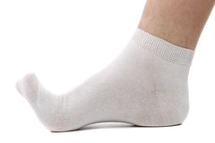 Sock and foot. Stock Photo