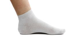 Sock and foot. . A white background. Royalty Free Stock Image