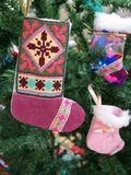 Sock on a fur-tree branch. Toys - a sock on a Christmas fur-tree royalty free stock photos
