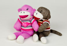 Sock Monkey Embrace Royalty Free Stock Photography