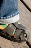 Sock and sandal. Colorful sock in leather sandal Stock Image