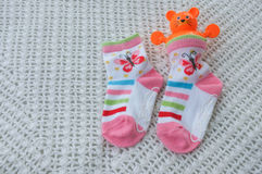 Sock and toy for baby on a soft Stock Photo