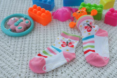 Sock and toy for baby on a soft Stock Image