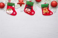 Sock waiting for Santa Claus Christmas gifts on whiteee wooden desk with decorations nad fir branches.  Royalty Free Stock Photos