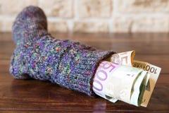 Socke voll des Geldes lizenzfreie stockbilder
